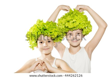 Two little girls with lettuce hair holding hands in heart shape. Healthy lifestyle, kids love veggie, vegetarian food concept. Isolated - stock photo
