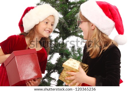 Two little girls with presents - stock photo