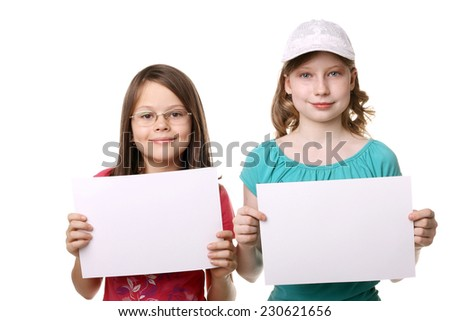two little girls with the blank sheets of paper - stock photo