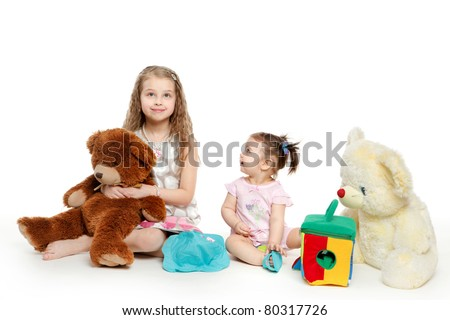 Two little girls with toys