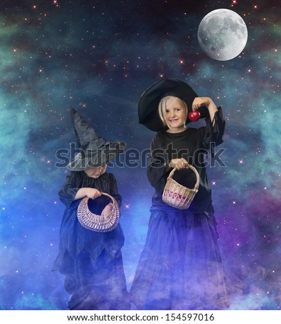 two little halloween witches, background with stars, space and moon - stock photo