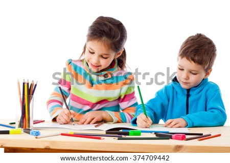 Two little kids draw with crayons together, isolated on white