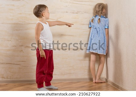 Two Little Kids Playing at Home While Parents are Out, Isolated on Wooden Walls - stock photo