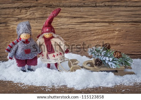 Two little santa decoration on wooden background