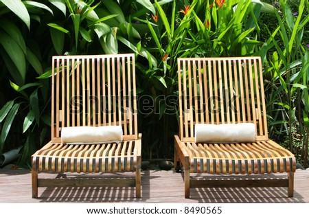 Two lounge chairs await guest at a five star spa - stock photo