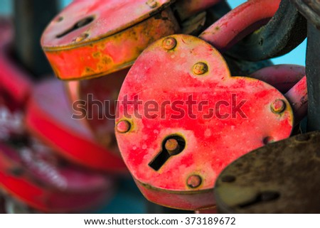 Two love locks. Padlock in the form of heart weathered. Macro shot.  - stock photo