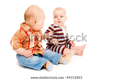 Two lovely baby boy friends, over white - stock photo