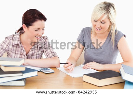 Two lovely female students doing their homework
