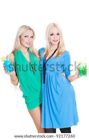 two lovely young women with cocktails over white background - stock photo