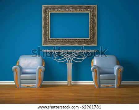 Two luxurious chairs with metallic console and picture frame in minimalist interior - stock photo