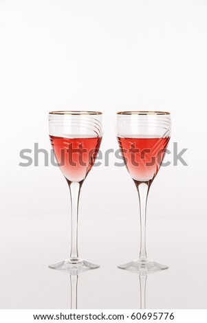 Two luxury wine glasses with white zinfandel wine - stock photo