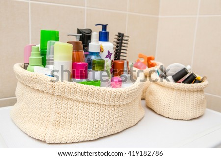 two make up bag with cosmetics and brushes - stock photo