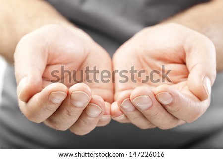 two male hands as if giving, showing or holding concept - stock photo