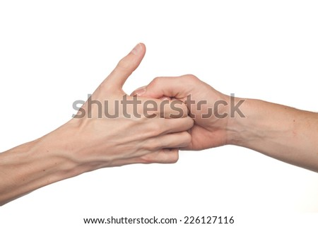 two male hands isolated on white playing a game of thumb wars - stock photo
