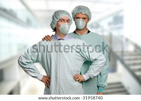 two male young doctors at the hospital - stock photo