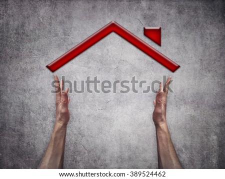 Two man hands making a house shape on gray background - stock photo