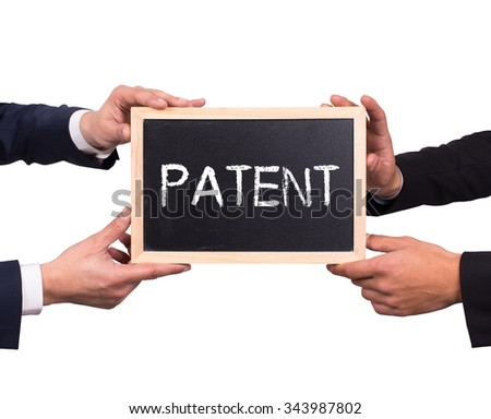 Two man holding mini blackboard with PATENT message - stock photo