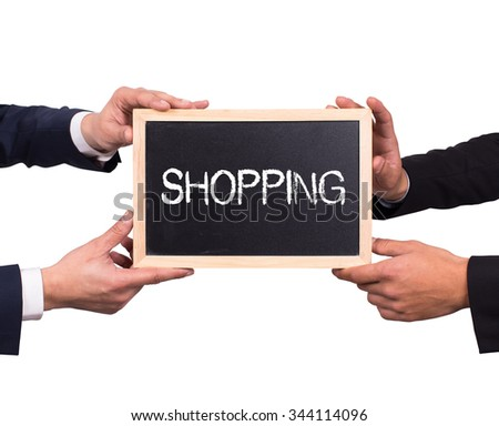 Two man holding mini blackboard with SHOPPING message - stock photo