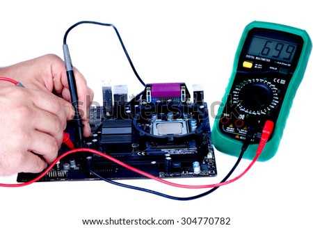 two man`s hands measuring the voltage of computer board isolated white - stock photo