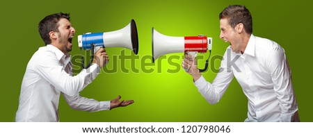Two Man Shouting On Megaphone On Green Background
