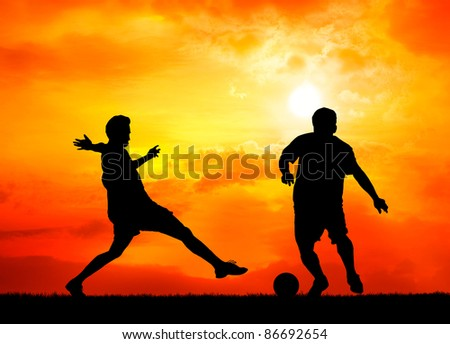 two man soccer player playing with ball during sunset silhouetted