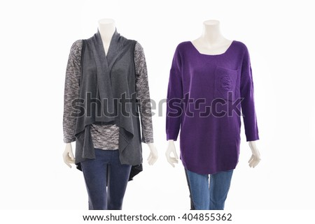 two mannequin female dressed in shirt and jeans on white background