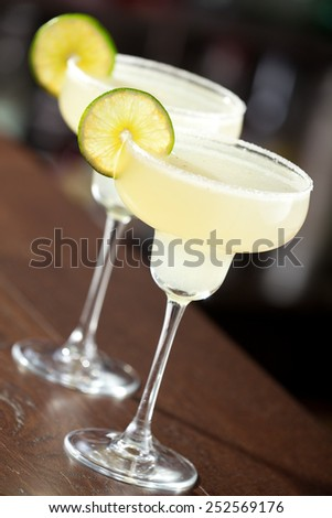 Two margarita cocktails on a bar - stock photo