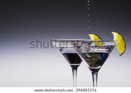 Two Martini glasses with lime slices  - stock photo