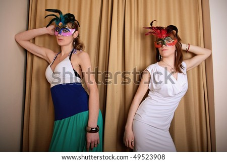 Two masked actress at theater. Concept of art, act, fashion, posing