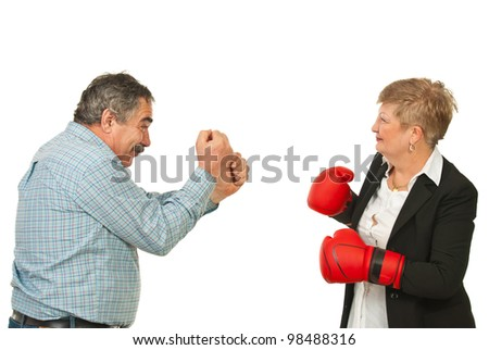 Two mature business people having confrontation isolated on white background