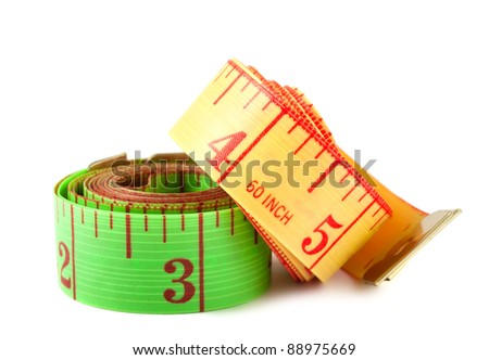 Two measuring tapes isolated on white background - stock photo