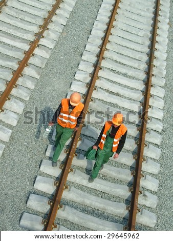 Two mechanic in hard hat on rails. 
