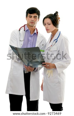 Two medical doctors discuss a patient's x-ray result. - stock photo