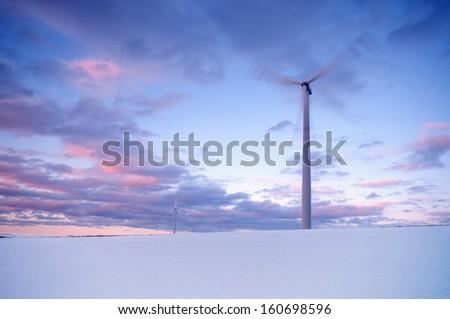 Two megawatt wind turbine on winter field - stock photo