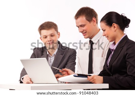 two men and youg woman discussing their ideas infront of laptop - stock photo
