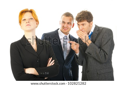 two men are whispering behind the back of a colleague - stock photo