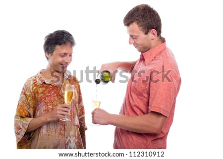 Two men celebrating with champagne, isolated on white background. - stock photo