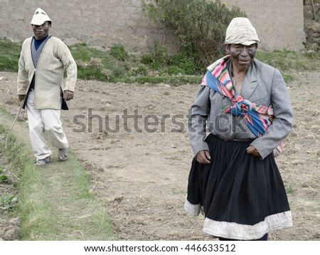 Two men dressed as husband and wife, an ancient ritual performed on local weddings in the highland Amaru community. October 22, 2012 - Amaru, Peru