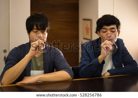 Two men drinking red wine