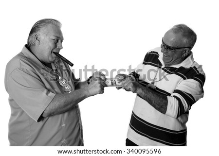 Two men fight over that last dollar in a tug of war to see who will end up with it. isolated on white with room for your text. - stock photo