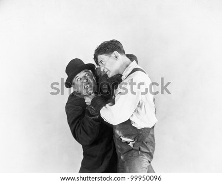 Two men fighting with each other - stock photo