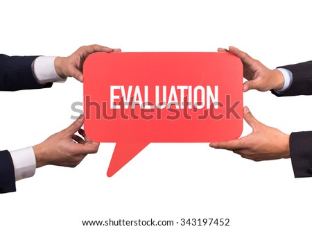 Two men holding red speech bubble with EVALUATION message - stock photo