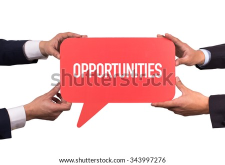 Two men holding red speech bubble with OPPORTUNITIES message - stock photo