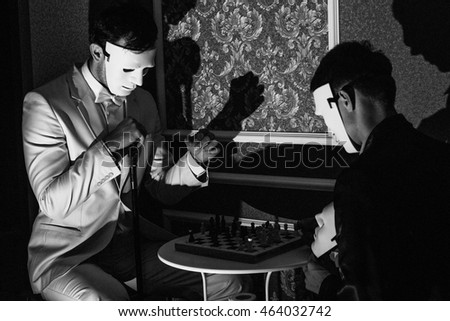 two men in masks