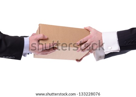 two men in suits giving and receiving a box isolated on white background - stock photo