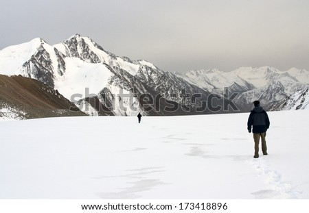 Two men in the mountains - stock photo