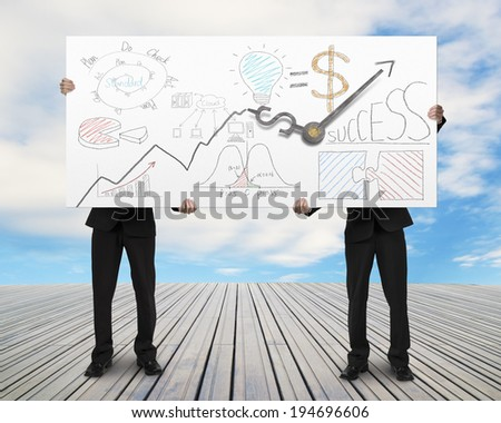 Two men lifting billboard with clock hands and doodles blue sky background - stock photo