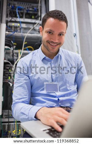 Two men looking at a car engine in a car shop - stock photo