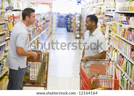 Two men meeting and talking in supermarket