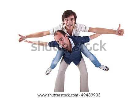 two men, one carrying on his back the other - stock photo